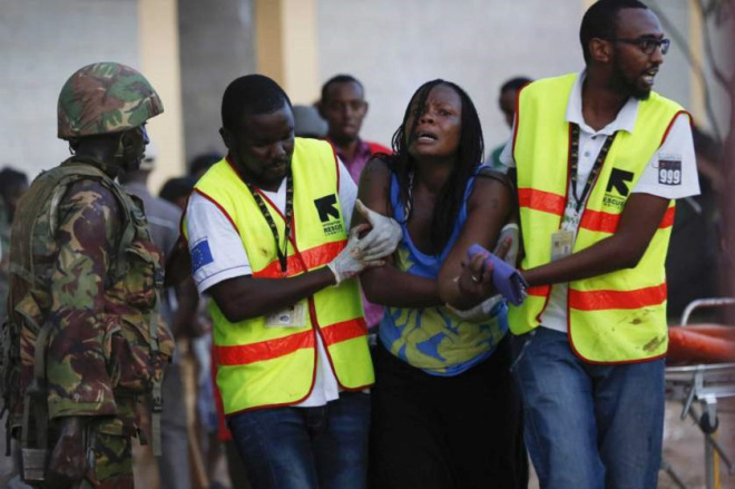 Woman escaping after terrorists targeted Christians at a university in Garissa, Kenya