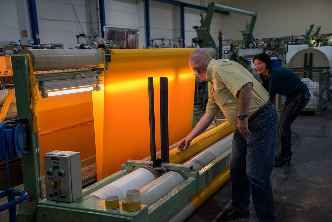 At the textile manufacturer Setex, 90,000 square meters of shimmering yellow fabric are produced, Greven, Germany, August 2014.Photo byWolfgang Volz.