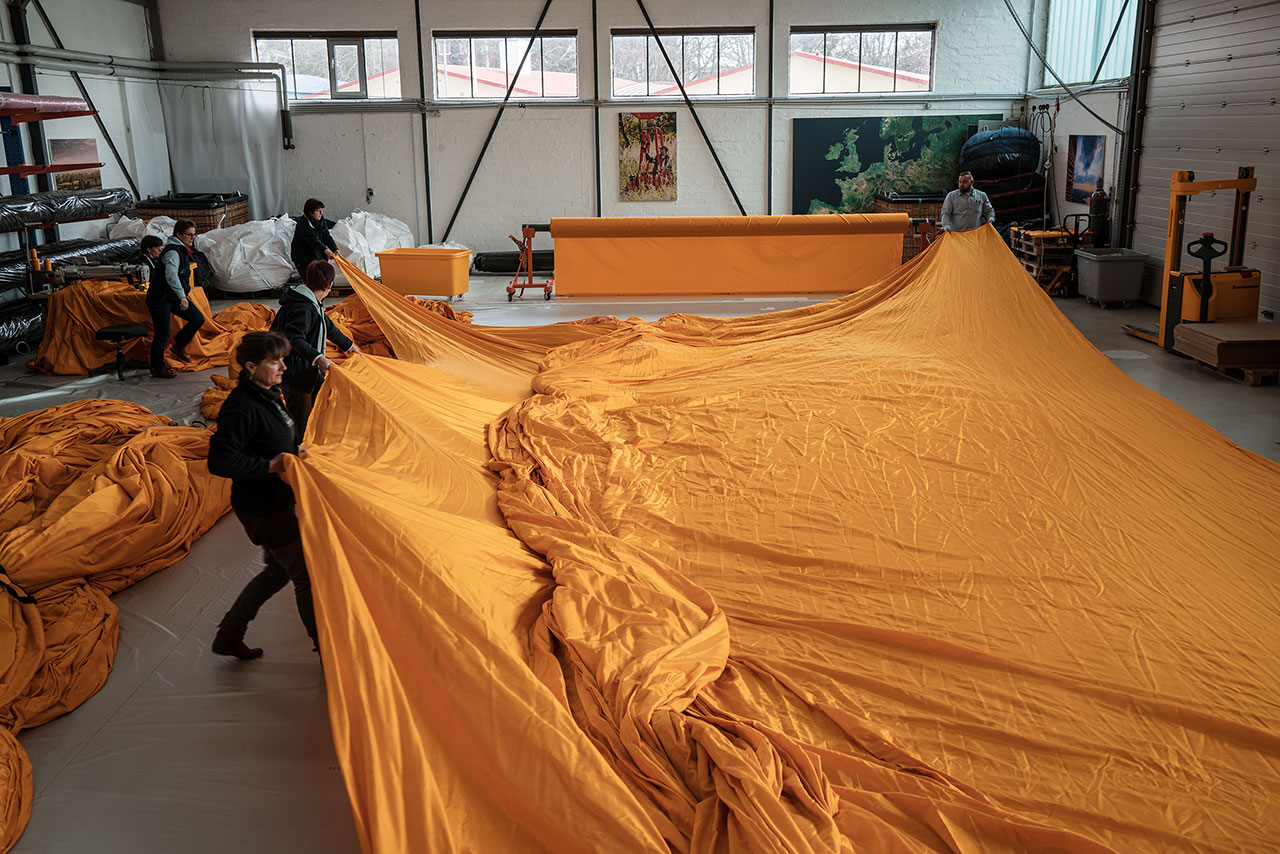 At geo – die Luftwerker, 75,000 square meters of yellow fabric are sewn into panels, Lübeck, Germany, February 2016. Photo by Wolfgang Volz.