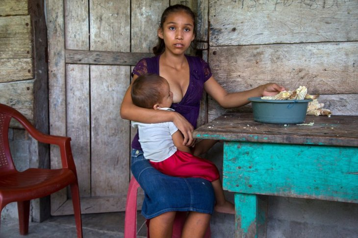 "<span class='image-component__caption' itemprop=""caption"">Aracely, 15, of Guatemala holds her infant. ""What I hope is to keep moving forward ... to see how I can get my boy ahead. The hard thing, maybe ... when he gets older and he leaves ... that's when is going to be hard for me. When he is older. Because he is the one who will help me get ahead."" Aracely is one of the half a million of Guatemalan girls who marry and give birth before they can legally vote, drink or buy cigarettes. </span>"