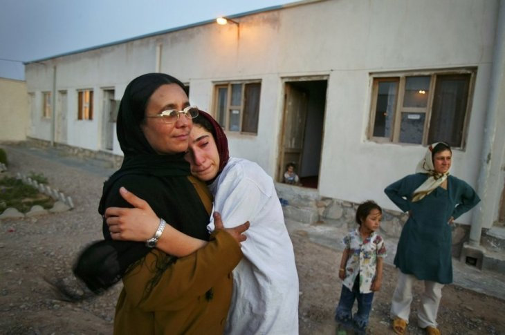 "<span class='image-component__caption' itemprop=""caption"">Mejgon, 16, weeps in the arms of her caseworker near fellow residents at an NGO shelter run by Afghan women in Herat, Afghanistan. Mejgon's father sold her at the age of 11 to a 60-year-old man for two boxes of heroin.</span>"