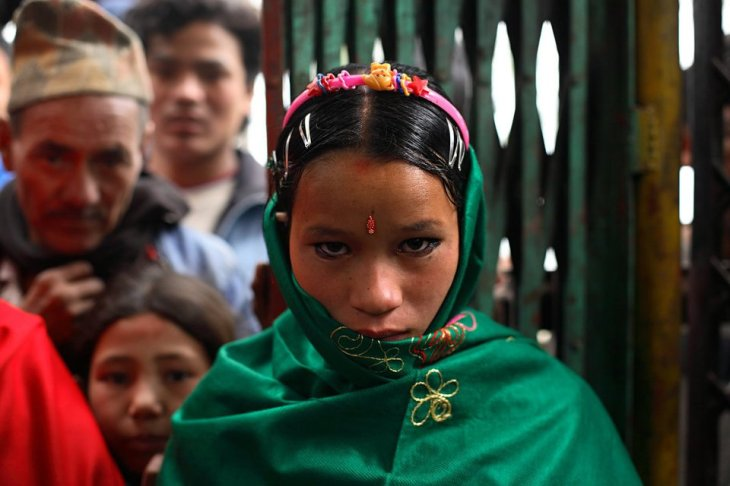 "<span class='image-component__caption' itemprop=""caption"">Niruta, 14, arrives at the wedding ceremony in Kagati Village, Kathmandu Valley, Nepal on Jan. 23 ,2007. Niruta moved in with the family of Durga, 17, and became pregnant when they were engaged. She was nine months pregnant at her wedding.</span>"